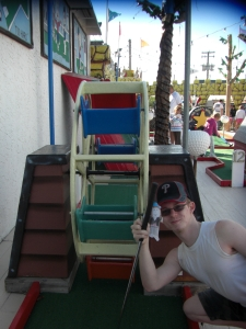 Emmy playing mini-golf on the boardwalk