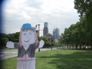 Emmy on the Benjamin Franklin Parkway with the city skyline